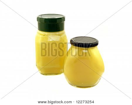 Butter Melted In A Glass Jar In Isolation On A White Background