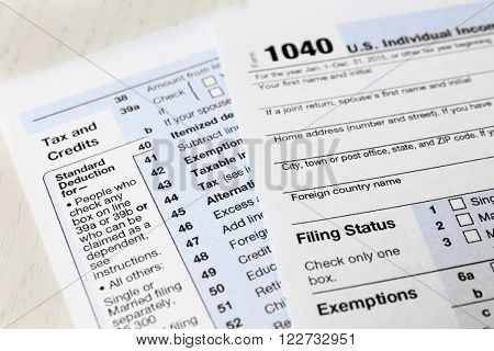 1040 Individual Income Tax Return Form for 2015 year on the white wooden desk, close up