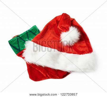 Santa's red hat cap and Christmas sock shaped bag stocking, composition isolated over the white background