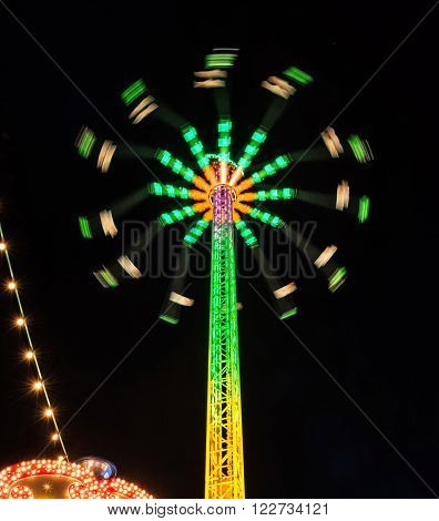 Carousel Star Flyer in the night. Free time activities.