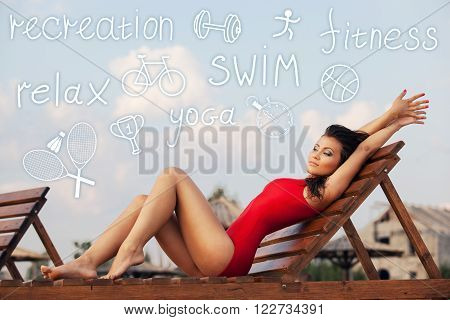 Young woman in red swimsuit lying on recliner with icons overhead