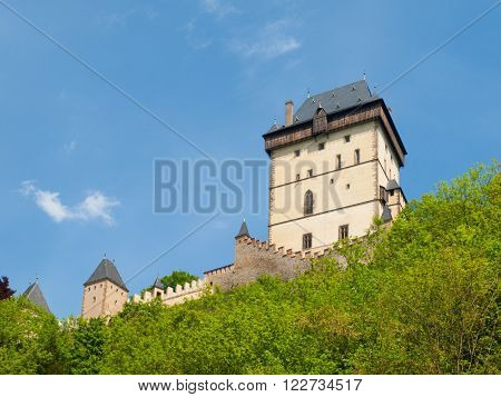 Great Tower of Karlstejn Royal Castle on sunny summer day with blue sky, gothic castle in Central Bohemia, Czech Republic