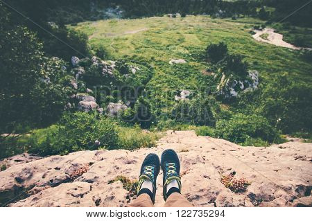 Feet Selfie running shoes Traveler relaxing on cliff mountains outdoor with aerial view forest on background Lifestyle hiking Travel concept summer vacations