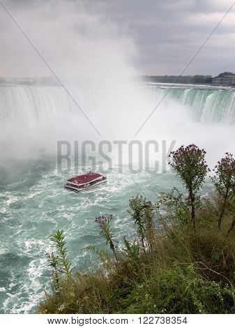 NIAGARA FALLS, ONTARIO, CANADA - September 19, 2015: The tourist boat  in Niagara Falls, Canada