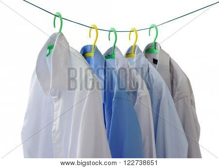 men's shirts drying on the clothesline