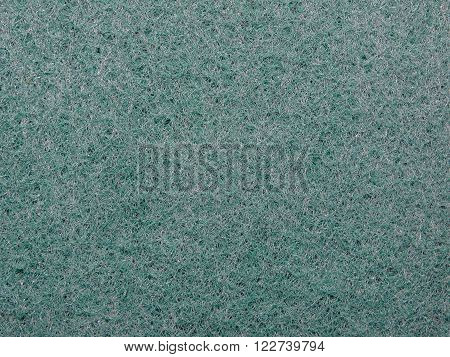 green porous sponge for cleaning and Drugova, closeup