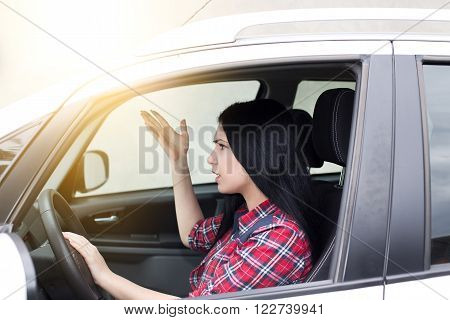 Young Upset Woman Drving Car