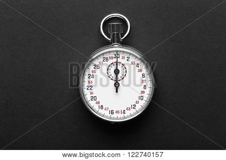 Stopwatch on black background, close up