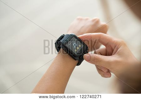 Hands of woman using smart watch, on her smart watch