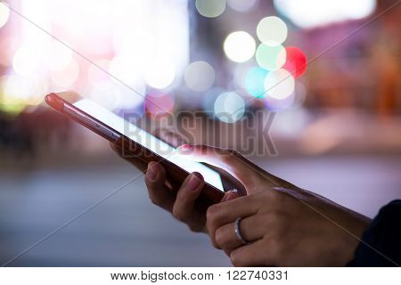 Woman using cellphone at night