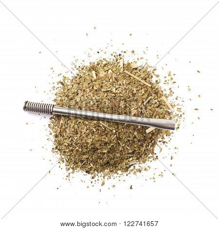 Pile of dry mate tea leaves with the bombilla drinking straw over it, composition isolated over the white background