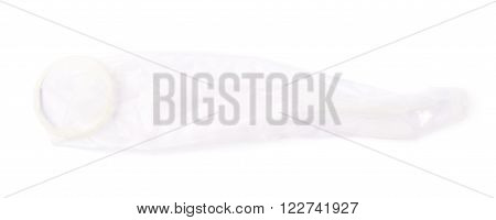 Unrolled latex condom isolated over the white background