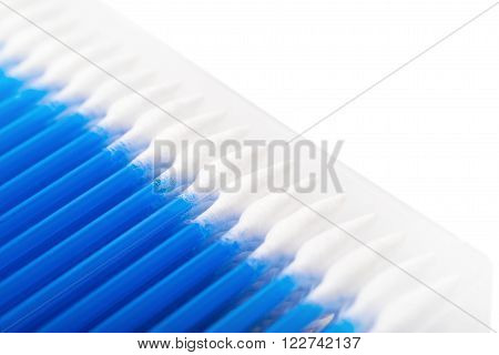 Box of cotton swab buds, close-up fragment crop as a copyspace backdrop composition isolated over the white background