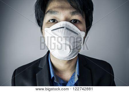 Close-up Asian guy wearing protective air mask