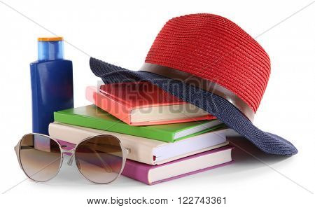 Travel set: books, hat, suntan oil and glasses, isolated on white