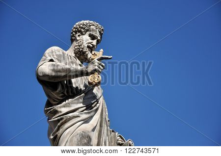 Statue of Saint Peter holding a key. Vatican city