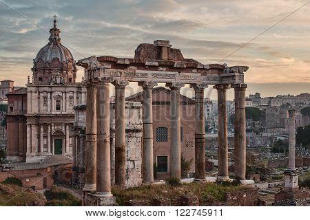 Rome, Italy: The Roman Forum, Latin: Forum Romanum, Italian: Foro Romano, in the sunrise. Santi Luca e Martina Church