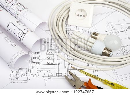 Architecture plan and rolls of blueprints with socket. Building concept