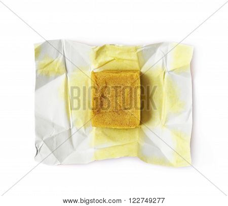 Unfolded bouillon stock broth cube isolated over the white background