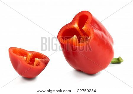 Cut Red Sweet Peppers Isolated On White Background