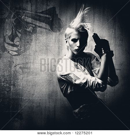 Attractive Blond Girl With Gun