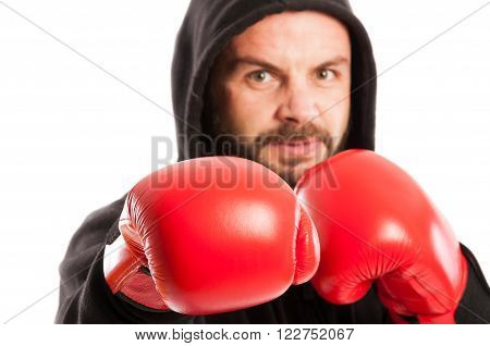 Close up of an angry amateur boxer with focus on the red glove