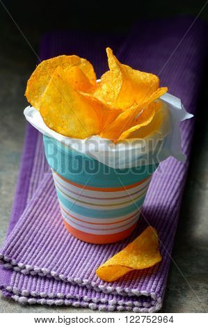 Paprika Potato Chips in small bowl, shoot in studio