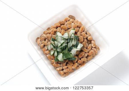 Natto, fermented soybeans with welsh onion on white background. (Japanese food)