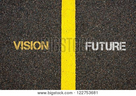 Antonym concept of VISION versus FUTURE written over tarmac, road marking yellow paint separating line between words