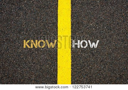 Road marking yellow paint dividing line between KNOW and HOW as word KNOWHOW, business concept