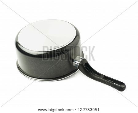 Teflon coated black sauce pan isolated over the white background