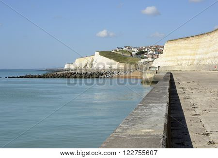 Seafront and cliffs at Rottingdean near Brighton East Sussex England. With unrecognisable people in background