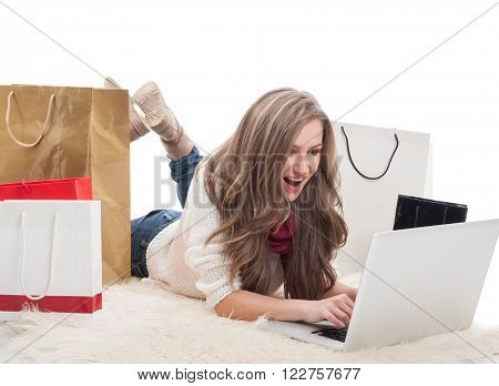 Online shopaholic concept with a woman buying and spending money on internet stores