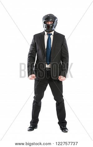 Suited business man wearing protective helmet and black suit on white background