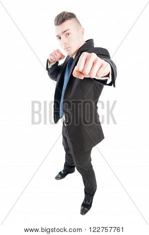 Confident and competitive business man punching the camera with naked fist