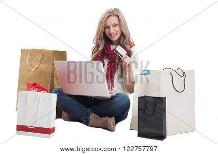 Satisfied shopping woman using credit or debit card to buy online. E-payment concept on white background