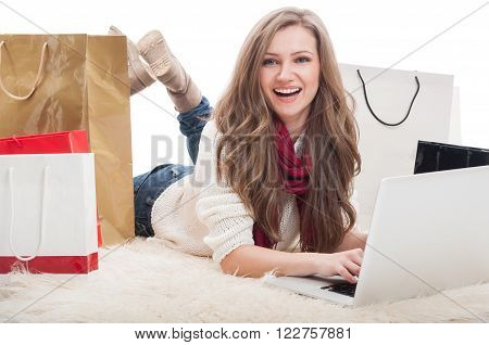 Beautiful And Young Female Shopper Using Laptop