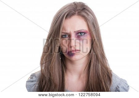 Injured woman with bruised eye and lip. Domestic violence against women concept on white background