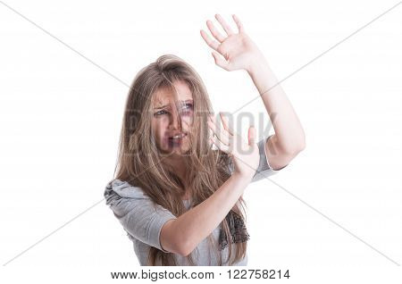 Abused And Scared Woman Protecting Herself