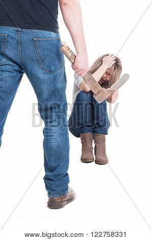 Man husband or boyfriend beating woman wife or girlfriend with a hoe on white background