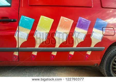 Elafonissons Island, Greece - August 24, 2015: Red whitewasher van with colorful brushes as logo in Elafonisos Island, Greece