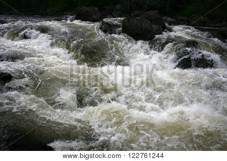 Threshold of the mountain river and wet stones