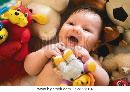 Smiling Baby Surrounded By Toys