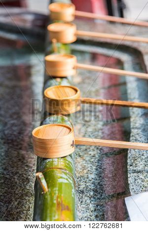 Close up of japanes wooden ladle in shrine yufuin kyushu japan.
