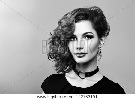 Portrait of beautiful sexy girl with curly red hair styling and professional makeup. Hairstyle. Luxury slender woman.