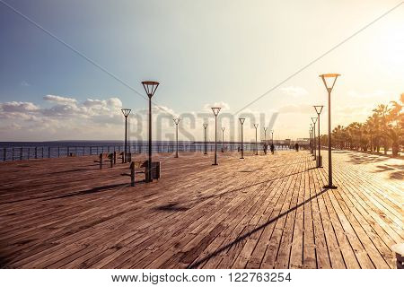 Molos Promenade on the coast of Limassol city Cyprus. Filtered photo with warm summer lighting.