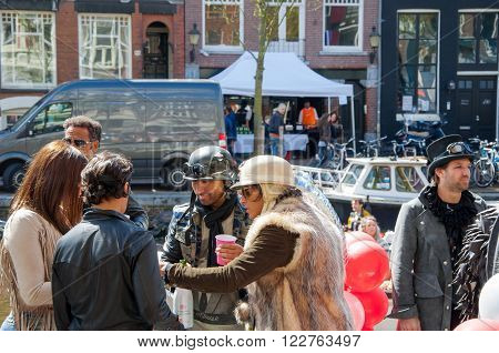 AMSTERDAM-APRIL 27: Unidentified town-dwellers solemnize King's Day on April 272015 in the Netherlands. King's Day is the largest open-air festivity in Amsterdam.