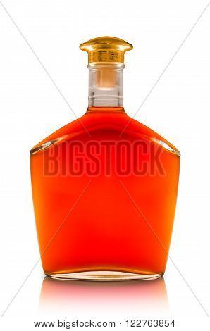 Cognac in a transparent bottle with gold cap close-up isolated on white background
