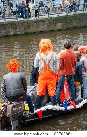 AMSTERDAM-APRIL 27: Undefined people in traditional orange celebrate King's Day on April 272015 the Netherlands. Orange is the color of the Dutch royal family dating back to William of Orange.