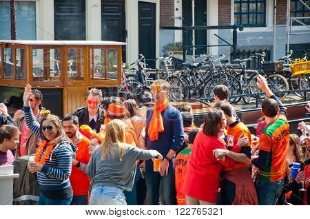 AMSTERDAM, NETHERLANDS - APRIL 27: Boat party on Amsterdam canal during King's Day on April 27, 2015 in Amsterdam. Kings Day is biggest festival celebrating the birth of Dutch royalty.